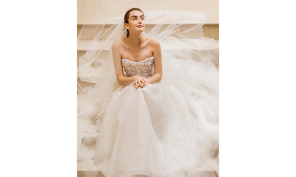 e7718c4907e Another absolute stunner from Herrera s  Made With Love  2019 bridal  collection is the  Hadley Gown  known for its intricately woven nature  inspired ...