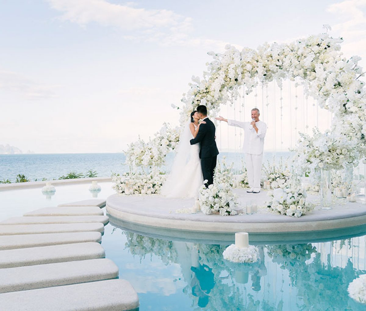 Chic White Wedding In Thailand With A Stunning Floral Backdrop